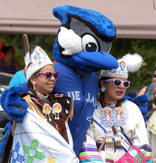 Ace, the Toronto Blue Jays mascot, poses with a pair of dancers at Walpole Island's National Aboriginal Day celebration held on Wednesday, June 21. The Toronto Blue Jays Jays Care Foundation was on hand, as they donated close to $140,000 to help refurbish two ball fields.