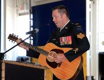 Sean Chase/Daily Observer Sgt. Johnny Whitehead performs a song in tribute to his close friend and fellow Dragoon, Sgt. Rob Dynerowicz. Family, friends and comrades gathered Monday to celebrate the life of the 34-year-old armoured soldier who died in a training accident in Wainwright, Alberta last April.