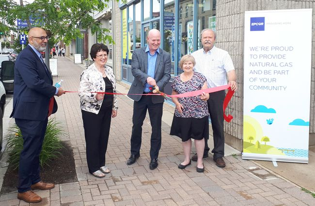 EPCOR cut the ribbon at its new office space Kincardine's Bruce Telecom storefront on June 23, 2017, to reach out to future customers. L-R: EPCOR's Karim Kassam, Municipality of Kincardine mayor Anne Eadie, EPCOR president and CEO Stuart Lee, Huron-Kinloss councillor Lillian Abbott, and Arran-Elderslie mayor Paul Eagleson. (Troy Patterson/Kincardine News and Lucknow Sentinel)