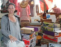 Danielle Sutton owner of I Want That Bag stands among piles of damaged goods due to water. (Ryan Berry/Kincardine News and Lucknow Sentinel)
