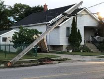 A photo via Twitter from Bluewater Power shows a hydro pole damaged on the weekend in Point Edward. The local electricity utility said 25 hydro, streetlight and signal light poles in its system have been damaged by vehicles so far this year. That compares to only a dozen damaged poles in all of 2016. (Handout/Sarnia Observer/Postmedia Network)