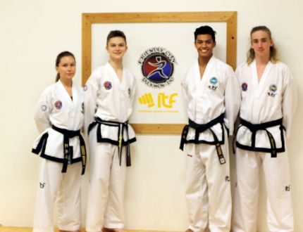 Friendly City Taekwon-Do won 18 medals, including nine gold, at the International Taekwon-Do Federation national championships June 2 and 3 in Longueuil, Quebec. The club had 13 students compete, including four black belt students, and two coaches at the national finals. From left: Yessica Bodera, Jacob Bodera, Noah Young and Cole Shearer. (Submitted photo)