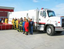 Fairview Fire Department received their new tanker truck earlier in the month and June 12 were getting ready for a training session to familiarize themselves with its operation. The tank holds 3,500 gallons of water and can empty into a portable tank (at left) in about three minutes.