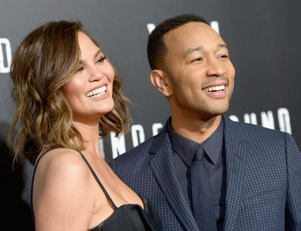 Model Chrissy Teigen (L) and actor/singer/executive producer John Legend attend WGN America's 'Underground' Season Two Premiere Screening at Regency Village Theatre on March 1, 2017 in Westwood, California. (Photo by Charley Gallay/Getty Images for WGN America)