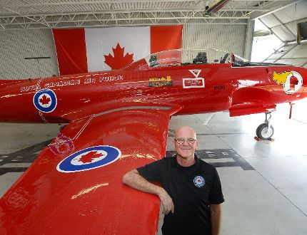 Simon Pont shows off a CT-133 Silver Star jet trainer — restored thanks to 1,200 hours of volunteer labour — which goes on display to the public today at London's Jet Aircraft Museum. (MORRIS LAMONT, The London Free Press)