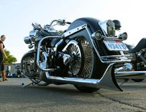 Riders walk past a Harley Davidson Heritage Softail Classic motorcycle at Peterborough Cycle Salvage on Thursday July 9, 2015. (Clifford Skarstedt/Postmedia Network)