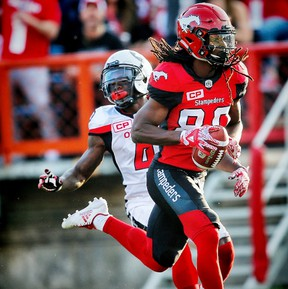 Calgary Stampeders Marken Michel with touchdown against the Ottawa Redblacks during CFL football in Calgary. (Al Charest/Postmedia)
