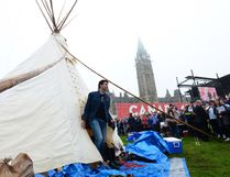 Prime Minister Justin Trudeau leaves a Teepee on Parliament Hill in Ottawa June 30. Trudeau had a brief meeting with indigenous activists who had set up a demonstration teepee on Parliament Hill ahead of Canada Day celebrations. THE CANADIAN PRESS/Sean Kilpatrick)