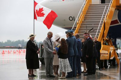 Prince Charles and Camilla are greeted after arriving at CFB in Trenton, Ontario on Friday June 30, 2017. The Princes of Wales and Duchess of Cornwall are beginning the second day of their royal tour at CFB Trenton. THE CANADIAN PRESS/Lars Hagberg