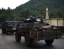 Philippine troops from the frontline drive past a mosque aboard their armoured personnel carrier this week on the outskirts of Marawi on the southern island of Mindanao where Islamist militants are occupying parts of a southern Philippine city. (TED ALJIBE/AFP Photo)