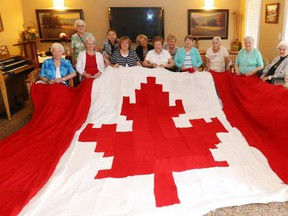 The Knotty Knitters working away at the Canadian Flag.  JEAN LEVAC