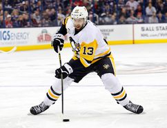 In this Dec. 22, 2016, file photo, Pittsburgh Penguins' Nick Bonino plays against the Columbus Blue Jackets during an NHL hockey game in Columbus, Ohio. The Western Conference-champion Nashville Predators took care of an area of concern, signing center Nick Bonino away from the Stanley Cup champion Penguins with a $16.4 million, four-year contract on Saturday, July 1, 2017. (AP Photo/Jay LaPrete, File)