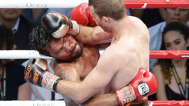 Manny Pacquiao of the Philippines, left, clinches with Jeff Horn of Australia, during their WBO World Welterweight title fight in Brisbane, Australia, Sunday, July 2, 2017. (AP Photo/Tertius Pickard)