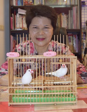 Fortune teller Miss Chen uses birds to help tell peoples' fortunes in a tiny cubicle near Taipei's Longshan Temple. (STEVE MACNAULL PHOTO)