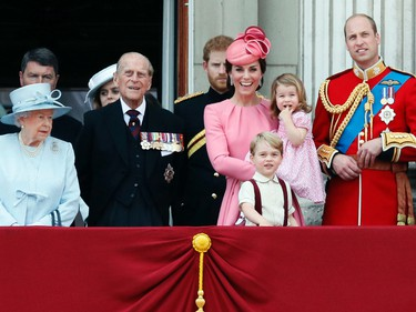 In this file photo dated Saturday, June 17, 2017, members of the British royal family with from left, Queen Elizabeth II, Prince Philip, Prince Harry, Princess Kate, The Duchess of Cambridge, with children Prince George and Princess Charlotte, Prince William, gather on the balcony of Buckingham Palace, after attending the annual Trooping the Colour Ceremony in London. (AP Photo/Kirsty Wigglesworth, FILE)