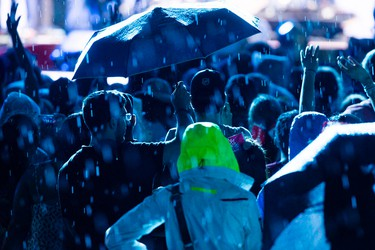 The skies opened up as Hedley closed the show at WE Day Canada Sunday July 2, 2017 on Parliament Hill.   Ashley Fraser/Postmedia