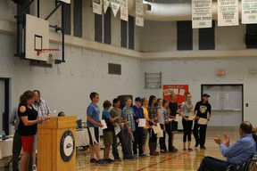 Matthew Halton's principal Mrs. Tanner hands out the Work Ethic Awards to the Grade 7 students. | Contributed photo/Matthew Halton