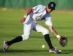 Second baseman Chris McQueen of the London Majors makes a nice play to his left and tracks down a ground ball for an out in the second inning of their game against the Brantford Red Sox in Labatt Park on Tuesday July 4, 2017. The Majors won 13-4. (MIKE HENSEN, The London Free Press)