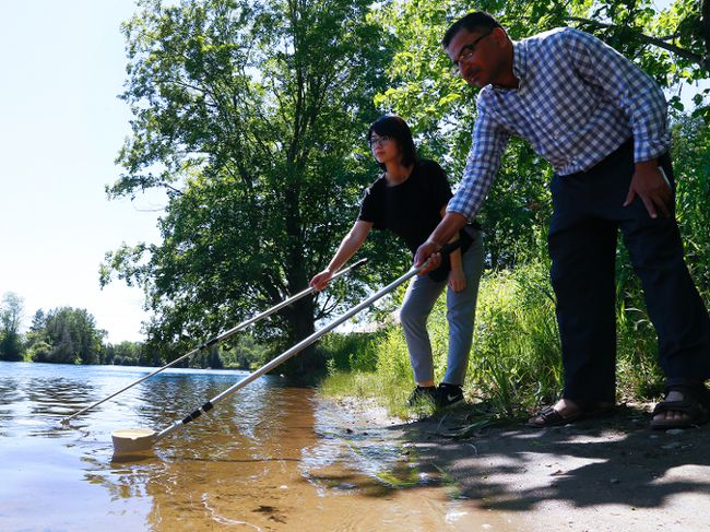 Peterborough Public Health students Muhammed Masood and Lillian Chan dip for larvae on Wednesday July 5, 2017 at the Riverview Park and Zoo in Peterborough, Ont. Health unit inspectors will begin testing mosquitos on July 14 for its West Nile virus program, which runs through September. CLIFFORD SKARSTEDT/PETERBOROUGH EXAMINER/POSTMEDIA NETWORK
