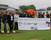 Members of the Town of Peace River council and committee, Northern Sunrise County, and Northern Lights County break ground with golden shovels for the new Peace Regional Recreation Centre on June 27 in Peace River.
