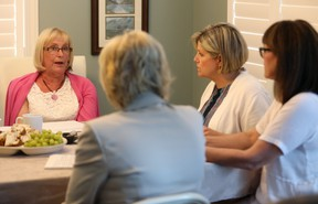 Carol Saxby, left, talks to London West MPP Peggy Sattler,  NDP Leader Andrea Horwath and London Fanshawe MPP Teresa Armstrong Wednesday about long-term care. Saxby?s mother has been in a home for 7 1/2 years and Saxby has noticed a decline in care as staff workload increases. (MIKE HENSEN, The London Free Press)