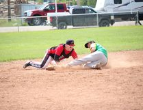 A runner gets tagged out during action at the 2016 Edson Kinsmen Slo-pitch Tournament. This year's tournament takes place Aug. 4 to 7 at Vision Park. (File photo)