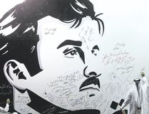 Qataris write comments on a wall bearing a portrait of Qatar's emir, Sheikh Tamim bin Hamad Al Thani, who has become the symbol of Qatari resistance during the month-long row with neighbouring countries. (KARIM JAAFARKARIM JAAFAR/AFP)