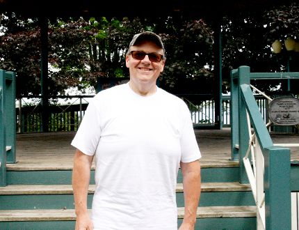 Chris Coyea, co-organizer of the Sunday in the Park concert series, poses at the Hardy Park gazebo in this 2017 photo.(FILE PHOTO)