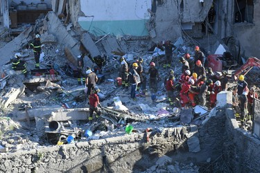 Rescuers work amid the rubble of a building that collapsed in Torre Annunziata, near Naples, southern Italy, Friday, July 7, 2017. (Ciro Fusco/ANSA via AP)