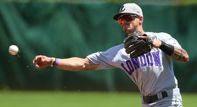 Chris McQueen of the Majors, wearing their Purple, Shine the Light on Woman Abuse uniforms throws out Ryan Rijo of the Barrie Baycats early in their Sunday July 9, 2017 doubleheader at Labatt Park.  (MIKE HENSEN, The London Free Press)