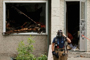 Edmonton Fire Rescue Services firefighters investigate a blaze in a home at 11612 88 Street in Edmonton on Sunday, July 9, 2017. Ian Kucerak / Postmedia