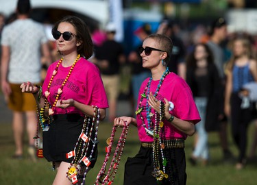 Volunteers were out in the sun selling Mardi Gras beads raising money for Blues in the Schools at RBC Bluesfest Sunday July 9, 2017.   Ashley Fraser/Postmedia