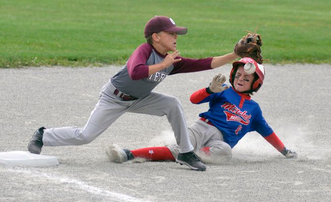 Caleb Templeman (right) of the Mitchell Mosquito OBA Astros slides safely into third base during round robin action last Friday against Tillsonburg, part of the 24-team Mosquito/Pee Wee tournament hosted by Mitchell minor baseball. Mitchell won easily, 17-0. ANDY BADER/MITCHELL ADVOCATE