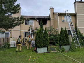 Firefighters quickly upgraded a blaze in a Herongate townhouse to a second-alarm Monday to keep the flames from spreading.