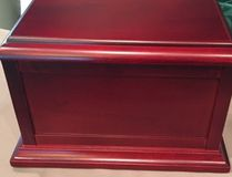 A cherrywood chest containing the ashes of Mary Myers was stolen from the deceased woman's Strathcona County residence on the evening of July 8, 2017.