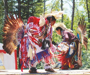 Two Native dancers from the Sunchild reserve perform onstage during a break between the arrival of the voyageurs and sprint races held during the afternoon of July 2 at Willey West campground.
