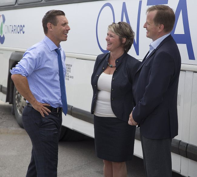 Ontario PC leader Patrick Brown chats with Patricia Riddell-Laemers, executive director of the Early Learning Centre, and Elgin-Middlesex-London MPP Jeff Yurek after a visit Tuesday, July 11 to the centre in St. Thomas. (DEREK RUTTAN, The London Free Press)