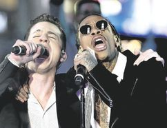 Wiz Khalifa, right, YouTube's top video draw for See You Again with Charlie Puth, puts on a live show at Rock the Park on Thursday. (Special to Postmedia News)