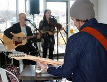 The Silkstones perform a sound check at the Gentry Expresso and Wine Bar on March 25 as they played before a full house. The band includes Dylan Jerome Wagner on lead guitar, front, Ryan Phillips and Megan Brown.