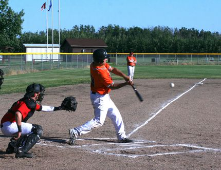 Outlaws player Cole Wiebe connects with the ball during the Outlaws home game against the Peace River Stampeders July 5.