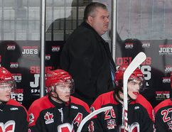 Peter Goulet, behind the Nepean Raiders bench during a Central Canada Hockey League game in April 2015, was named head coach of the Ontario Junior Hockey League's Kingston Voyageurs last week. He will remain the Voyageurs general manager, a position he has held the past two seasons. (Postmedia Network file photo)