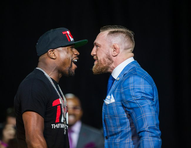 Boxing champ Floyd Mayweather (left) and UFC lightweight champion Conor McGregor are face to face promoting their upcoming boxing match during an appearance at Budweiser Stage in Toronto, Ont. on Wednesday July 12, 2017. Ernest Doroszuk/Toronto Sun/Postmedia Network