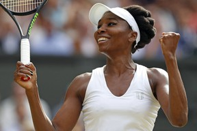 Venus Williams celebrates beating Johanna Konta during the Wimbledon Championships at The All England Lawn Tennis Club in Wimbledon on July 13, 2017. (ADRIAN DENNIS/Getty Images)