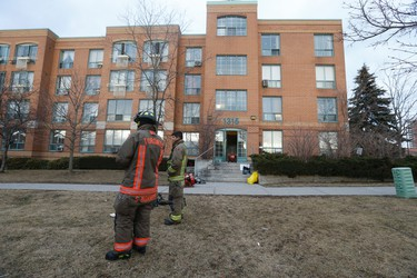Firefighters at the scene after a fire broke out around 3 p.m. at a TCHC seniors residence at 1315 Neilson Rd. on February 5, 2016. (Jack Boland/Toronto Sun)