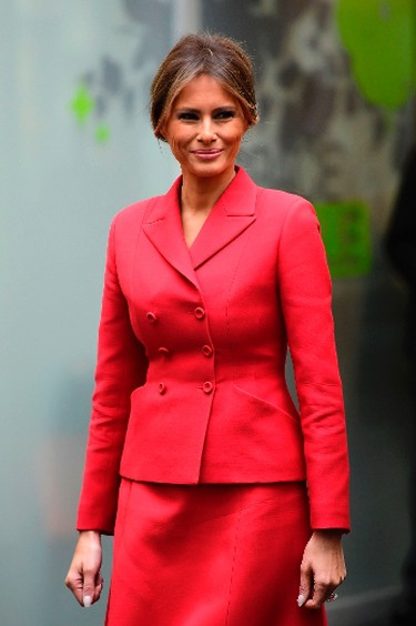 """Melania Trump arrived in Paris Thursday wearing head-to-toe Republican red to begin a two-day presidential visit that will take in France's Bastille Day celebrations.   The U.S. First Lady nailed diplomatic style in her bright red Christian Dior skirt suit, paired with sleek red pumps.    Her stylist, Herve Pierre – A French-born American citizen who also designed her inaugural gown – put a lot of thought into the look, according to WWD. The pair wanted to pay homage to Dior's 70th anniversary as well as a Dior-inspired retrospective at Les Arts Decoratifs.    """"I always try to find something that has a little meaning without being too intellectual. We speak about everything. It is a nice conversation and it's positive. I am always trying to find something that respects the protocol, the religion or the country that she is visiting,"""" Pierre told WWD.    In honour of this stunning look, here are 10 other recent Flotus fashion moments that we loved. - Postmedia Network   (AFP PHOTO / Martin BUREAUMARTIN BUREAU/AFP/Getty Images)"""