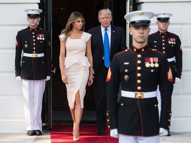Pretty in pink: US President Donald Trump and First Lady Melania Trump walk out to receive South Korean President Moon Jae-in and his wife Kim Jeong-suk at the White House in Washington, DC, on June 29, 2017. (NICHOLAS KAMM/AFP/Getty Images)