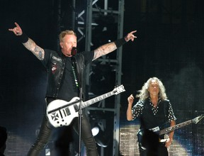 """James Hetfield, left, and Kirk Hammett of the band Metallica perform in concert during their """"WorldWired Tour"""" at M&T Bank Stadium on Wednesday, May 10, 2017, in Baltimore. (Owen Sweeney/Invision/AP)"""