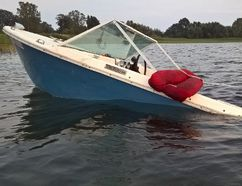 A boat abandoned by Pottahawk partygoers still sits in Lake Erie five days after the event. Contributed Photo/Facebook