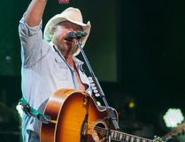 Country music star Toby Keith raises a red solo cup while onstage as part of the Interstates and Tailgates Tour at SMS Equipment Stadium inside Shell Place in Fort McMurray Alta. on Thursday July 13, 2017. Robert Murray/Fort McMurray Today/Postmedia Network