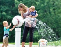 Ashley Pennings and her two sons, Aiden (left), 3 and Carson, 11-months, spent some time last Wednesday, July 12 at the West Perth Lions Pool splash pad finding a way to beat the heat. ANDY BADER/MITCHELL ADVOCATE